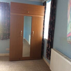 Wardrobe with full length mirror and dressing table both in good condition.