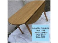 Drop leaf circular table pine veneer good condition DELIVERY INCLUDED