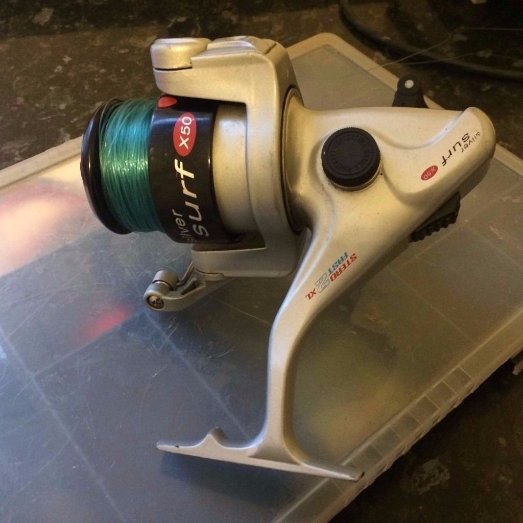 Fishing reel - silver surf x50 and accessories