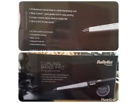 Brand new,never used,in the box babyliss curling wand pro.