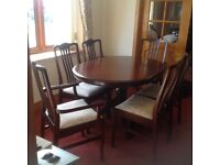 Mahogany dining table which extends/6 chairs