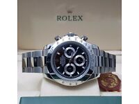 Silver Rolex Daytona with Black Face Automatic Sweeping Hands