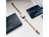 Gucci gold watch with box, authenticity card and receipt