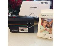 Polaroid instant print digital camera and pack of 50 ZINK zero ink sheets