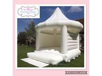 White wedding bouncy castle with canopy