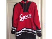 Red Supreme Hockey Top