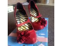 Red irregular shoes size 3