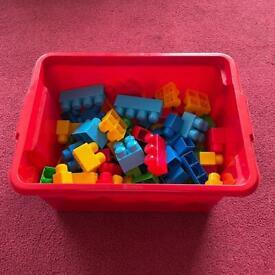 125-pieces of Mega Bloks - toddler building blocks - with storage box