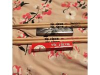 Two pairs of Vic Firth drumsticks