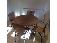 Conservatory table and four chairs (with arms) from John Lewis