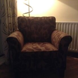 Brown fabric 2 seater sofa + 2 brown patterned chairs matching pillows on soaf