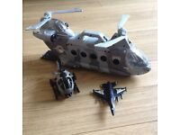 Army toys icluding tanks and helicopters