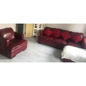 Dark red corner sofa and tub chair