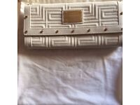 Versace leather bag with gold belt.