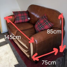 Small brown leather-effect sofa