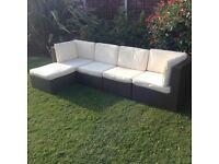 rattan garden patio/conservatory corner sofa with cream cushions £260 ono tel 07966921804