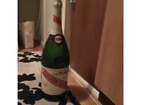 Very very big champagne bottle empty very good condition first to see will buy grab a bargain