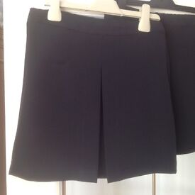 2 Debenhams navy blue school skirts, new without tags, aged 8 years