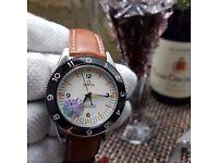 New white face black ceramic bezel brown leather bracelet Omega Seamaster classic automatic swiss