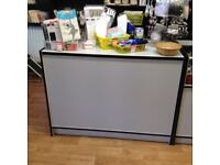 Shop counter with shelves under