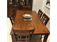Dining table with 6 chairs in good condition
