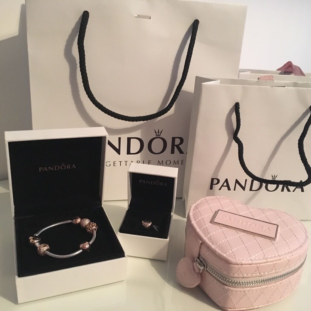 New authentic Pandora bracelet rose gold with 6 charms and free box! Comes with receipt and boxin Halesowen, West MidlandsGumtree - Authentic Pandora bracelet set PANDORA ROSE OPEN YOUR HEART BRACELET £125 PAVÉ BALL CHARM £70 TUMBLING HEARTS CHARM £70 SHIMMERING HEART CHARM £55 RRP £320 With free pink Pandora jewellery box With boxes, receipts and bags Message me for more...