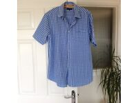 Two men's shirts , size medium, new condition