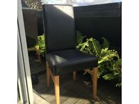Dining chairs - 4 dark brown leather dining chairs.