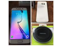 Samsung galaxy s6 edge, smart watch and charging pad