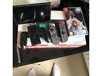 Nintendo switch console plus fifa and Zelda