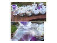 Glass bowls, with tea light holders. Ideal for wedding table decorations