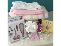 White wicker hamper sleeping gift for the new baby