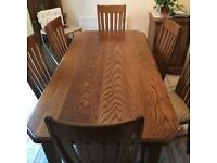 Solid wood table and 6 chairs in excellent condition