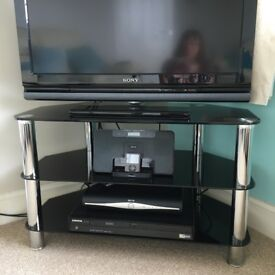 Smoked glass and chrome tv unit with 3 x 3tier corner shelf units.
