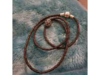 Black Pandora bracelet and Pandora charm