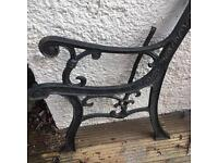 A PAIR OD SOLID IRON BENCH ENDS