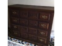 Beautiful antique chest of drawers in a dark wood