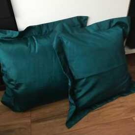 Four teal and brown cushions
