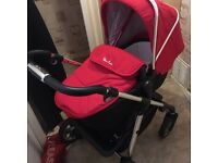 Silvercross pioneer pushchair in chilli red