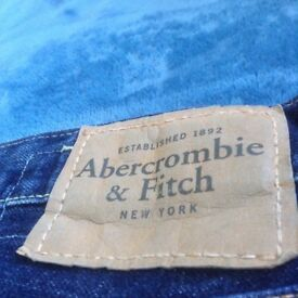 Men's blue distressed jeans by Abercrombie & Fitch.