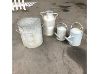 Job lot of watering cans, milk churn, large planter.