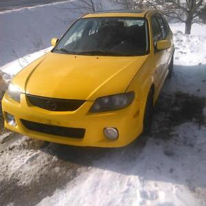 2003 Mazda Protege yellow Hatchback