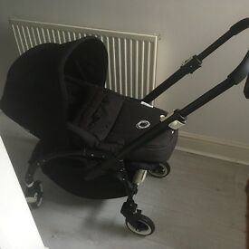Bugaboo bee buggy with maxi cosi adapters, cocoon, black and or red sun canopy and rain cover.