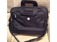 Lap top bag in strong nylon. Various zipped compartments.