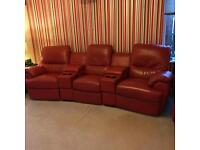 Red leather cinema sofa plus swivel chair and foot stool