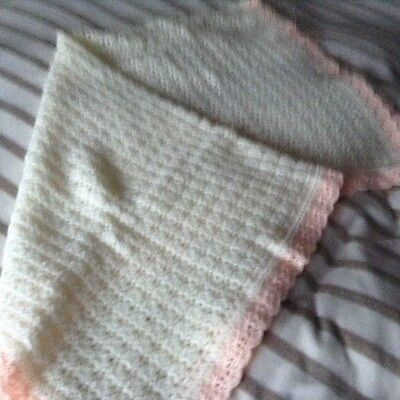 A new hand crochet baby girl blanket /shawl in cream a nd pink 4 ply yarn