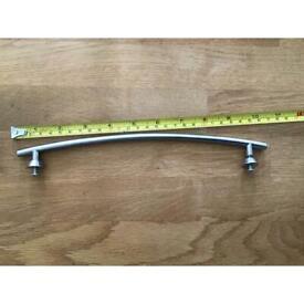 Curved cupboard door handles