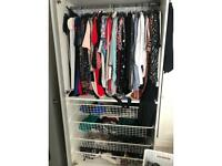 White pax IKEA wardrobe with 4 baskets and shelf. Also have two mirrored doors