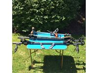 Athlet roof rack for guttered vehicle with figments for windsurfer, mast or bicycle