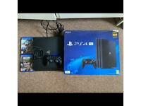 PS4 Pro 1Tb 4K Jet Black with 2 games Monster Hunter and CoD WWII one controller